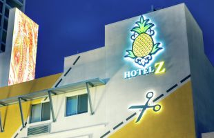Exterior detailed view of hotel facade and sign