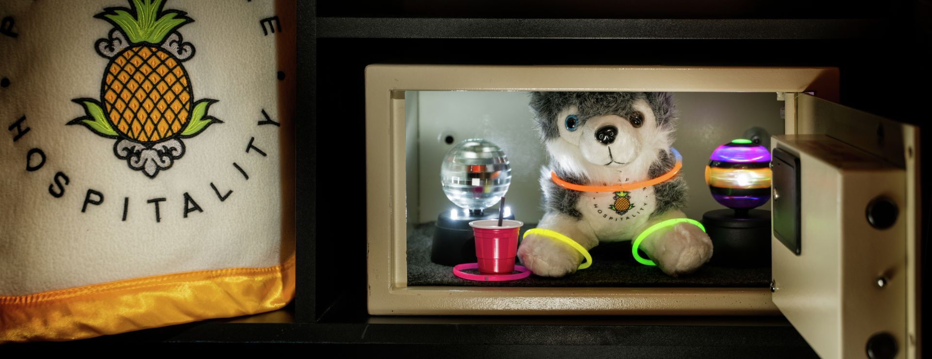 Dash doll in guestroom safe with glow bracelets and disco ball
