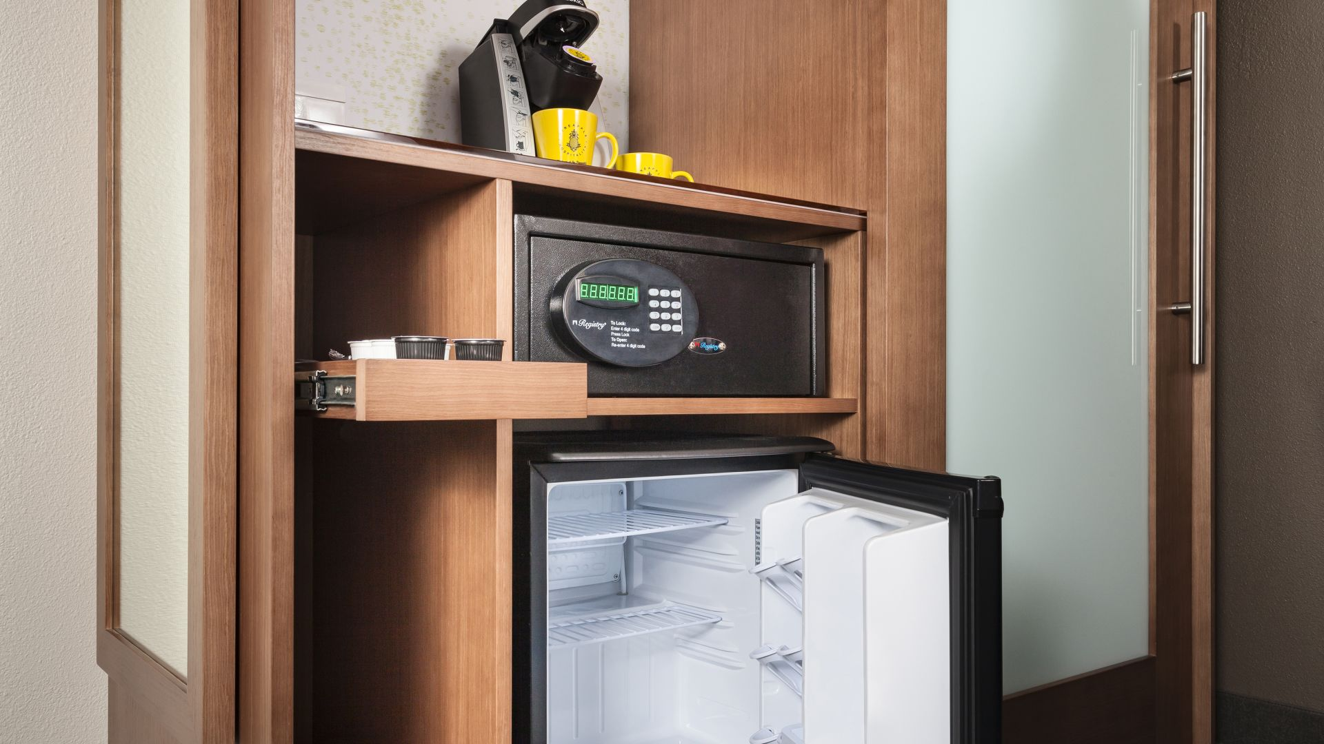 Coffee maker, microwave, and mini-fridge area in the Traditional Two Queen guestroom