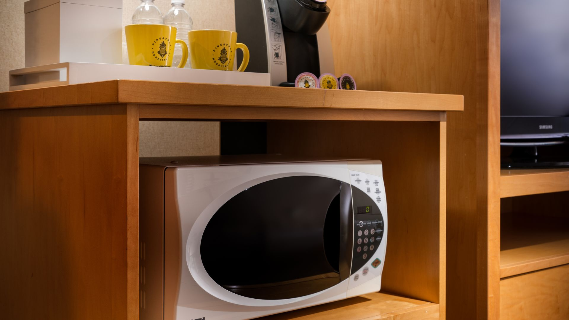 Coffee maker, microwave, and mini-fridge area in the Deluxe King guestroom