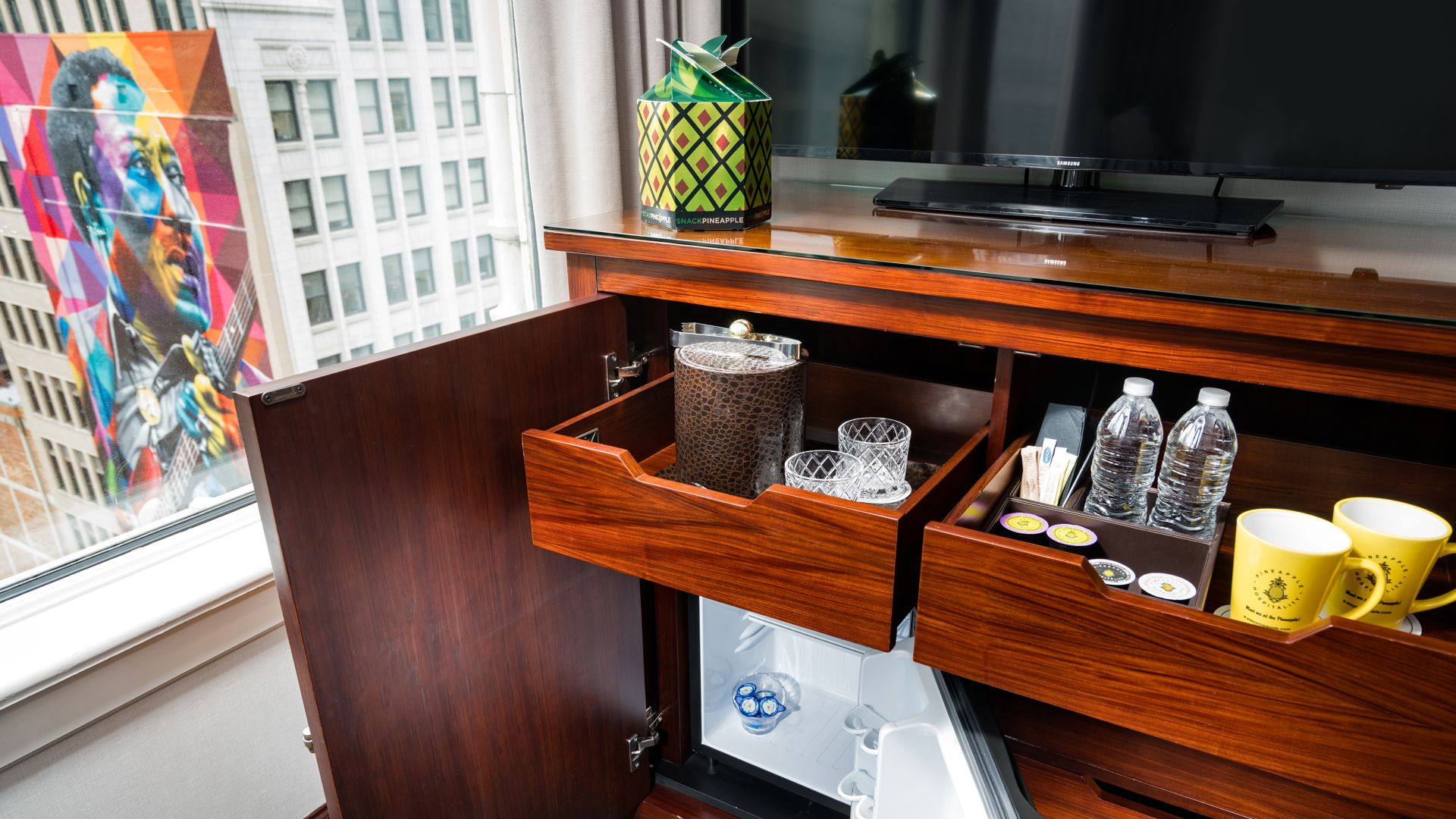 Executive King Suite room amenities with bottled water and mini-fridge