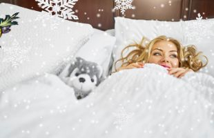 Winter Savings promotion image of women in bed covers with snowflakes
