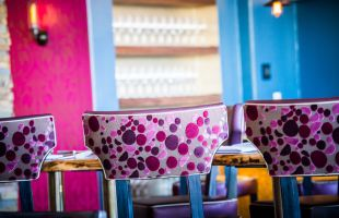 Colorful bar stools in one of our restaurants